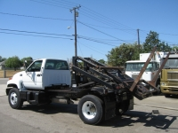1999 Chevy C6500 with G&H Container Delivery Unit