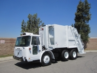 2000 Volvo WXLL64 Xpeditor with Pak-Mor 16 Yard Rear Loader Garbage Truck