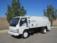 2006 Isuzu NQR with New Way 8 Yard Diamondback Rear Loader Refuse Truck