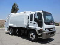 1999 GMC T8500 with McNeilus 17 Yard Rear Load Refuse Truck