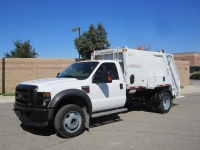 2009 Ford F450 with New Way 6 Yard Diamondback Rear Loader Refuse Truck