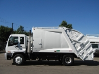2002 GMC T8500 with McNeilus 17yd Rear Loader Refuse Truck