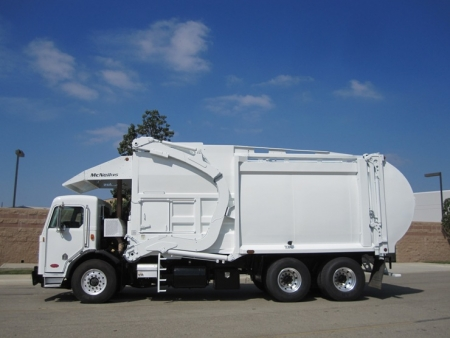 2009 Peterbilt 320 with McNeilus Atlantic 40 Yard Front Load Refuse Truck