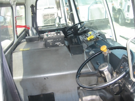 1999 Volvo WXLL64 Refuse Truck with Heil Rapid Rail Automated Side Loader