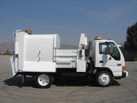 2000 GMC W5500 with Wayne Tomcat 6yd Satellite Side Loader Refuse Truck