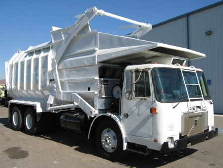 2000 Volvo WXLL64 with Amrep 40 Yard Front Load Refuse Truck