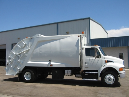 2003 Sterling Acterra with McNeilus 20yd Rear Loader Refuse Truck